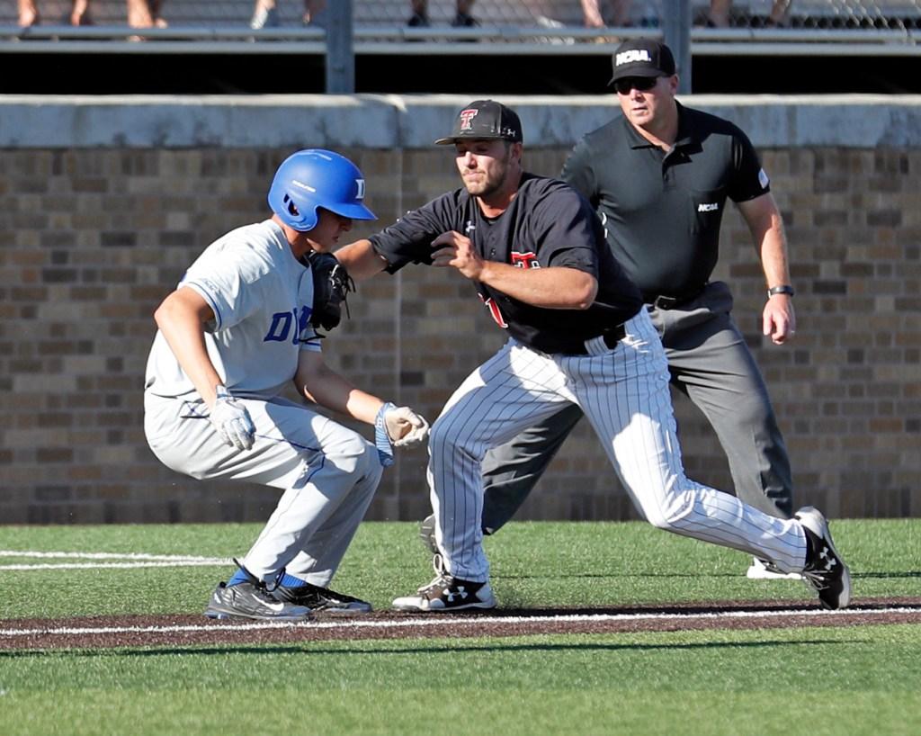 Texas Tech's Dylan Dusek (41) tags out Duke's Zack Kone (2) during an NCAA college baseball tournament super regional game against Duke, Monday, June 11, 2018, in Lubbock, Texas. [Brad Tollefson/A-J Media]