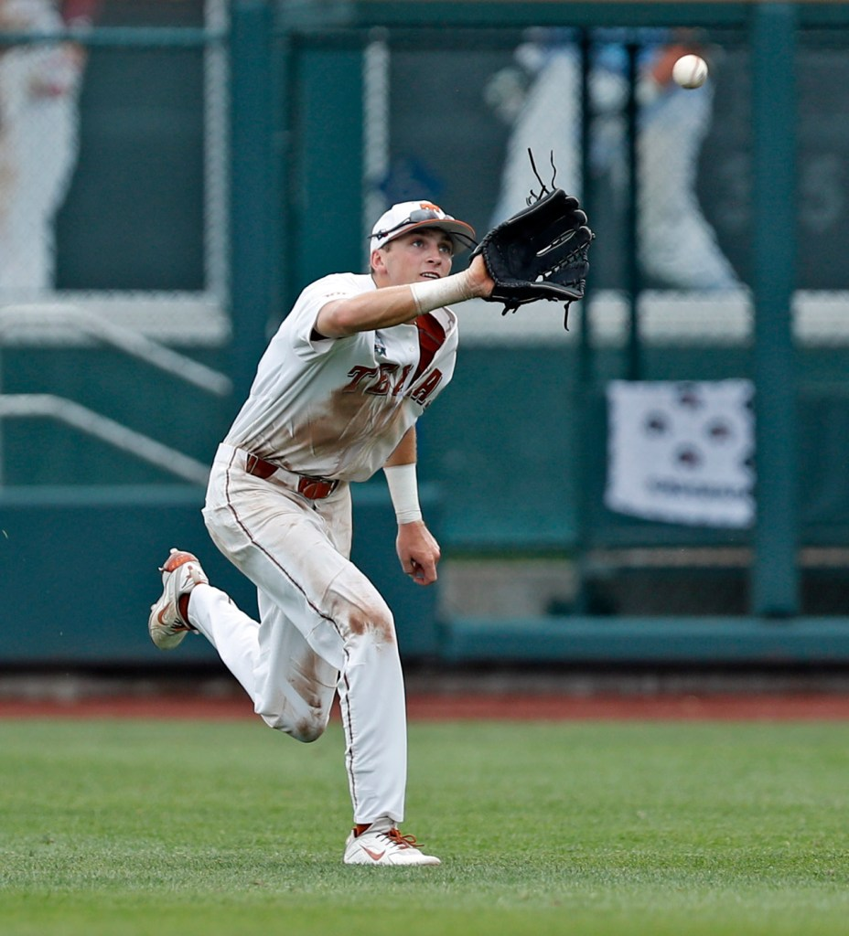 Texas' Duke Ellis (11) catches a fly ball during a College World Series baseball game against Florida, Tuesday, June 19, 2018, at TD Ameritrade Park in Omaha, Neb. [Brad Tollefson/A-J Media]