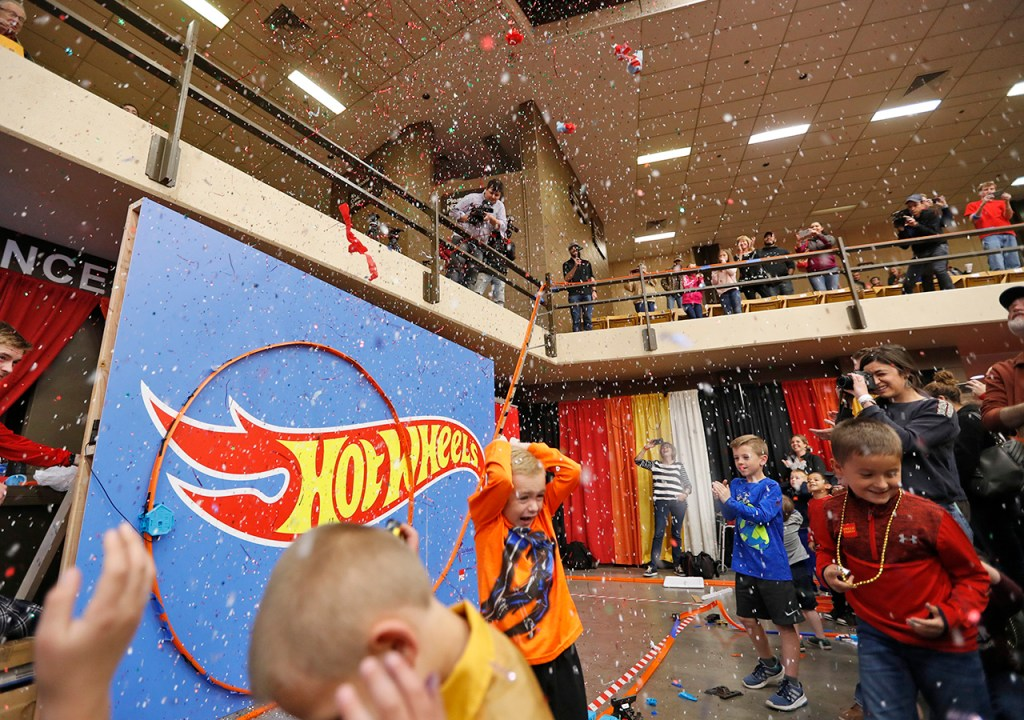 The crowd cheers in the confetti after Monterey students broke the record for worlds longest Hot Wheels track during the Lubbock Arts Festival, Saturday, April 14, 2018, at Lubbock Memorial Civic Center in Lubbock, Texas. [Brad Tollefson/A-J Media]