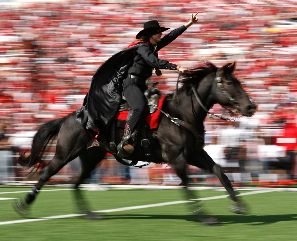 The Masked Rider runs onto the field before an NCAA college football game against West Virginia, Saturday, Sept. 29, 2018, in Lubbock, Texas. (AP Photo/Brad Tollefson)