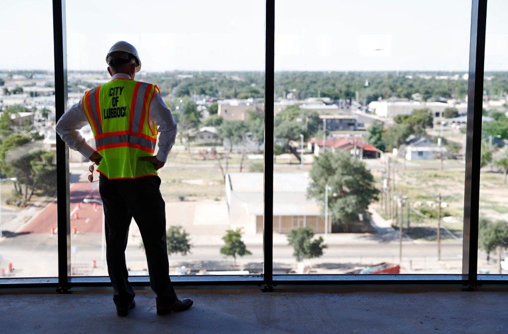 Lubbock mayor Dan Pope looks out the window of the seventh floor during a tour of Citizen's Tower, Monday, July 16, 2018, in Lubbock, Texas. Citizen's Tower will house City Hall once renovations are complete. [Brad Tollefson/A-J Media]