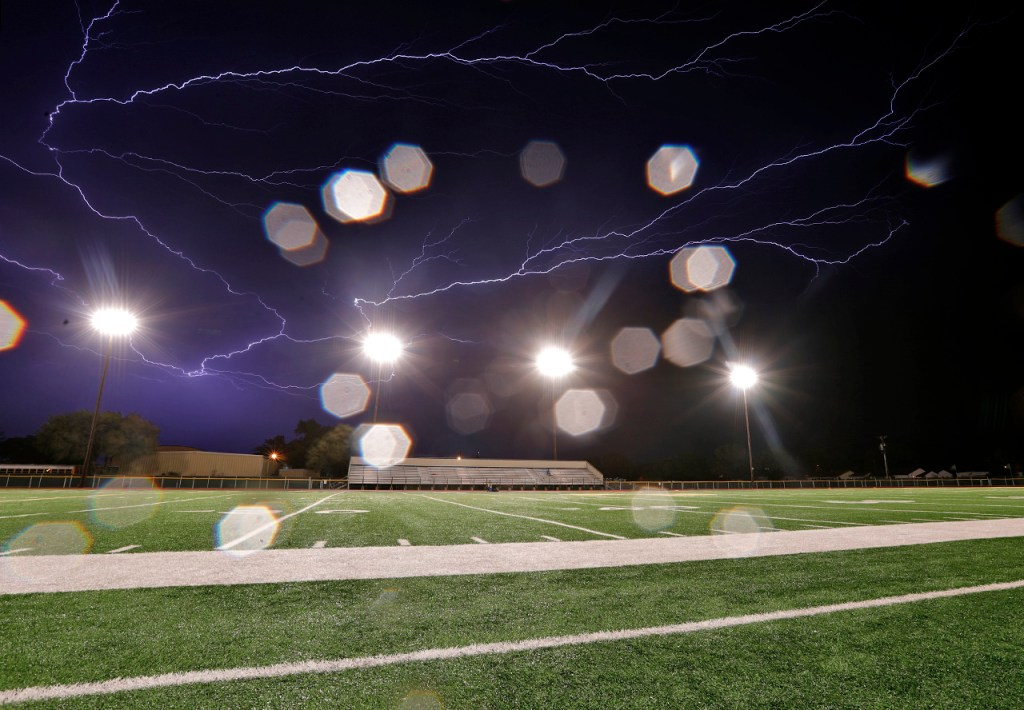Lightning strikes in the sky during a delay in the game between New Deal and Trinity Christian, Friday, Oct. 5, 2018, in New Deal, Texas. [Brad Tollefson/A-J Media]