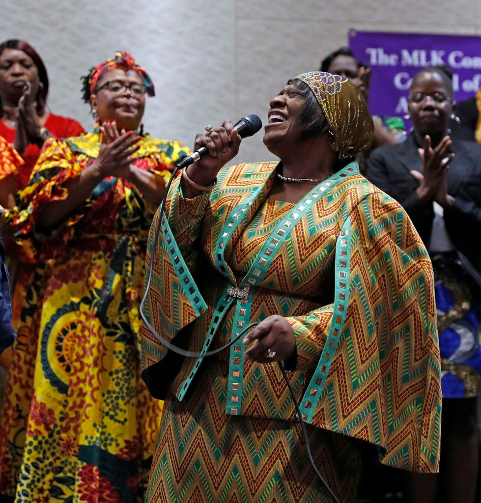 Geraldine Thompson sings praise songs with the MLK mass choir during the Martin Luther King Jr. gospel night Monday, Jan. 21, 2019, at Lubbock Memorial Civic Center in Lubbock, Texas. [Brad Tollefson/A-J Media]