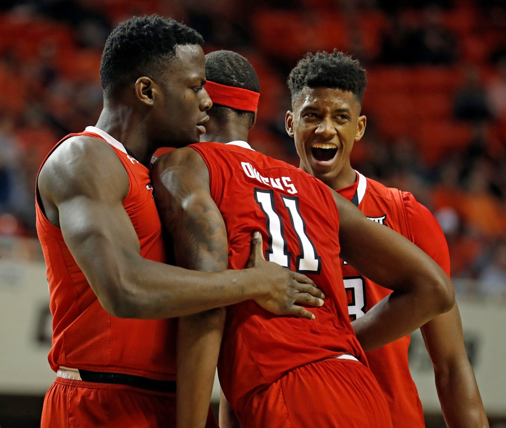Texas Tech's Norense Odiase (32), Tariq Owens (11) and Jarrett Culver (23) celebrate with each other during the game against Oklahoma State, Wednesday, Feb. 13, 2019, at Gallagher-Iba Arena in Stillwater, Okla. [Brad Tollefson/A-J Media]
