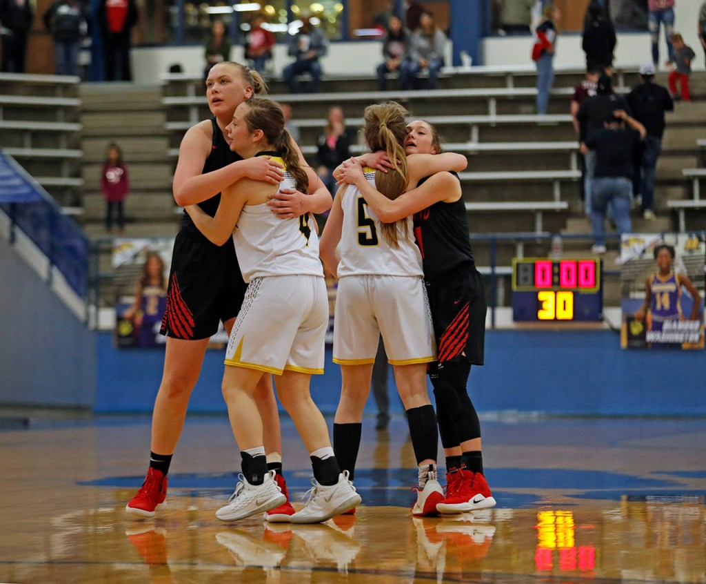 Levelland and Seminole players hug each other after the area round playoff game, Thursday, Feb. 14, 2019, at Frenship High in Wolfforth, Texas. [Brad Tollefson/A-J Media]