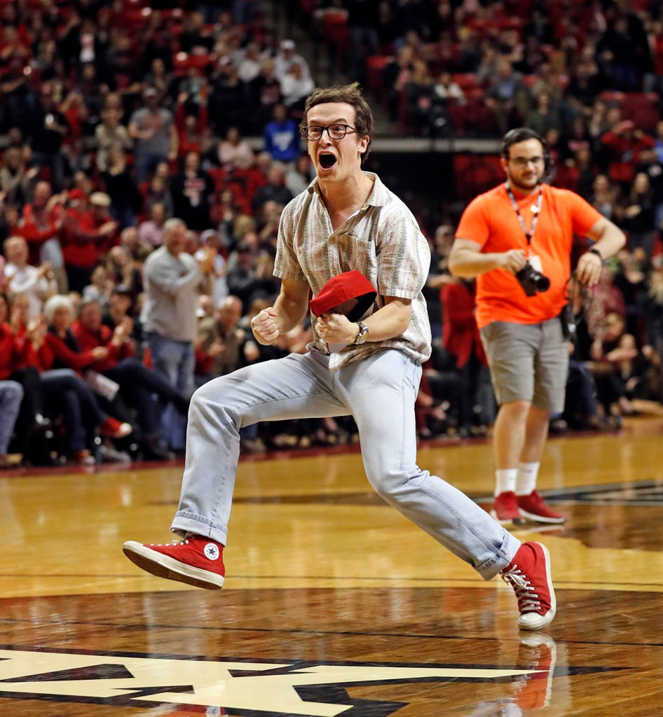 William Nolen, from San Angelo, celebrates after scoring a half-court shot to win a trip to Las Vegas during the first half of an NCAA college basketball game against Oklahoma State, Wednesday, Feb. 27, 2019, in Lubbock, Texas. (AP Photo/Brad Tollefson)