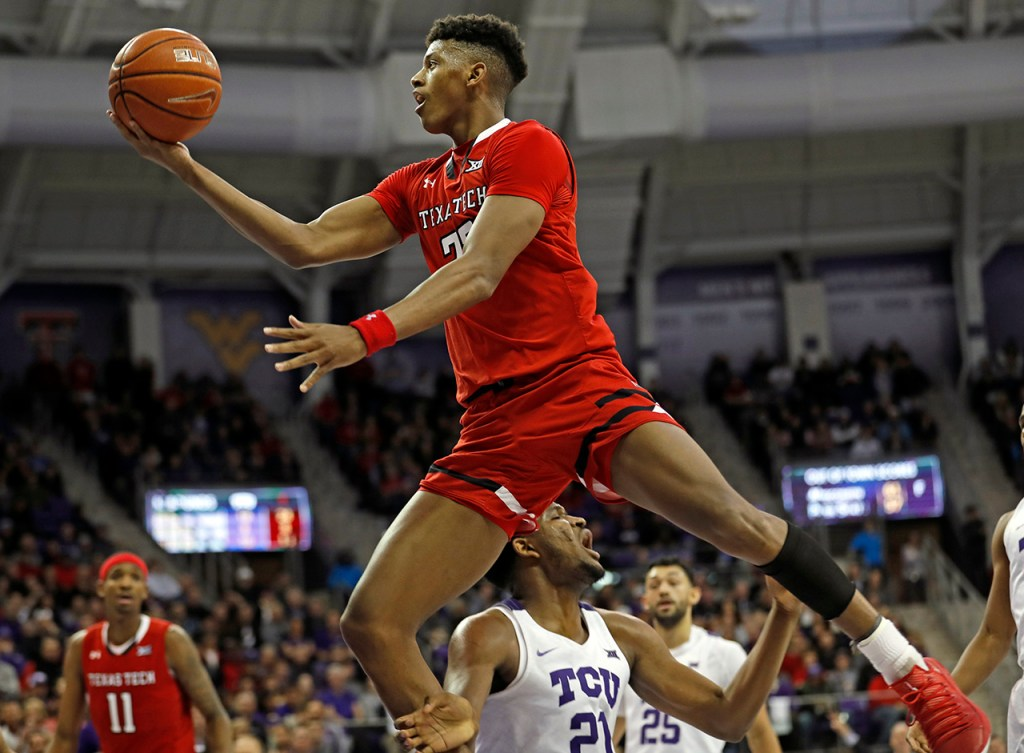 Texas Tech's Jarrett Culver (23) lays up the ball over TCU's Kevin Samuel (21) during the game Saturday, March 2, 2019, at Schollmaier Arena in Fort Worth, Texas. [Brad Tollefson/A-J Media]