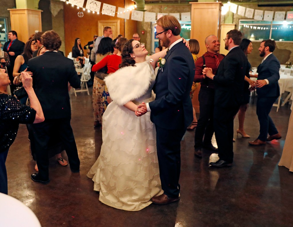Sam and Kimberly Grenadier dance together during their wedding reception Saturday, March 9, 2019, at McPherson Cellars in Lubbock, Texas. (Brad Tollefson)