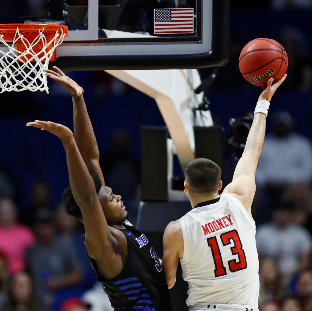 Texas Tech's Matt Mooney (13) shoots the ball over Buffalo's Nick Perkins (33) during the NCAA tournament second round game Sunday, March 24, 2019, at BOK Center in Tulsa, Okla. [Brad Tollefson/A-J Media]