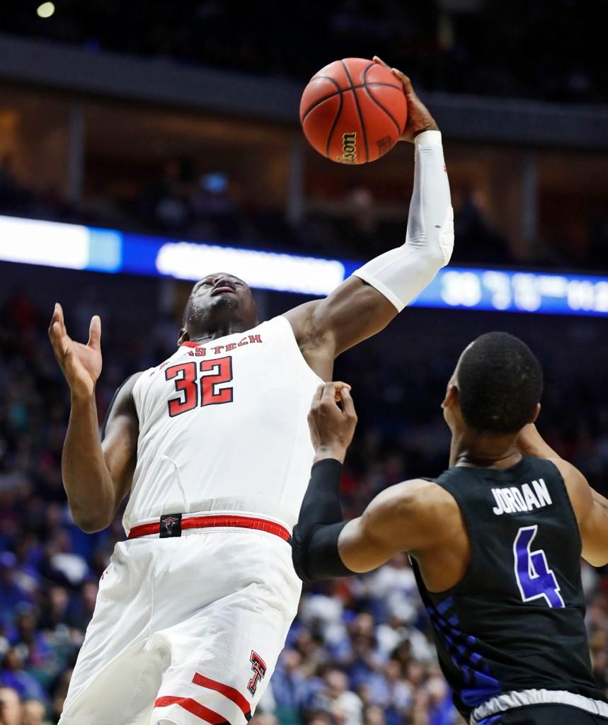 Texas Tech's Norense Odiase (32) rebounds the ball during the NCAA tournament second round game against Buffalo, Sunday, March 24, 2019, at BOK Center in Tulsa, Okla. [Brad Tollefson/A-J Media]
