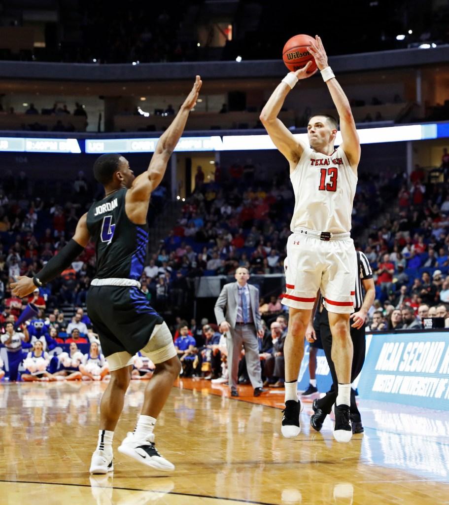 Texas Tech's Matt Mooney (13) shoots the ball during the NCAA tournament second round game against Buffalo, Sunday, March 24, 2019, at BOK Center in Tulsa, Okla. [Brad Tollefson/A-J Media]