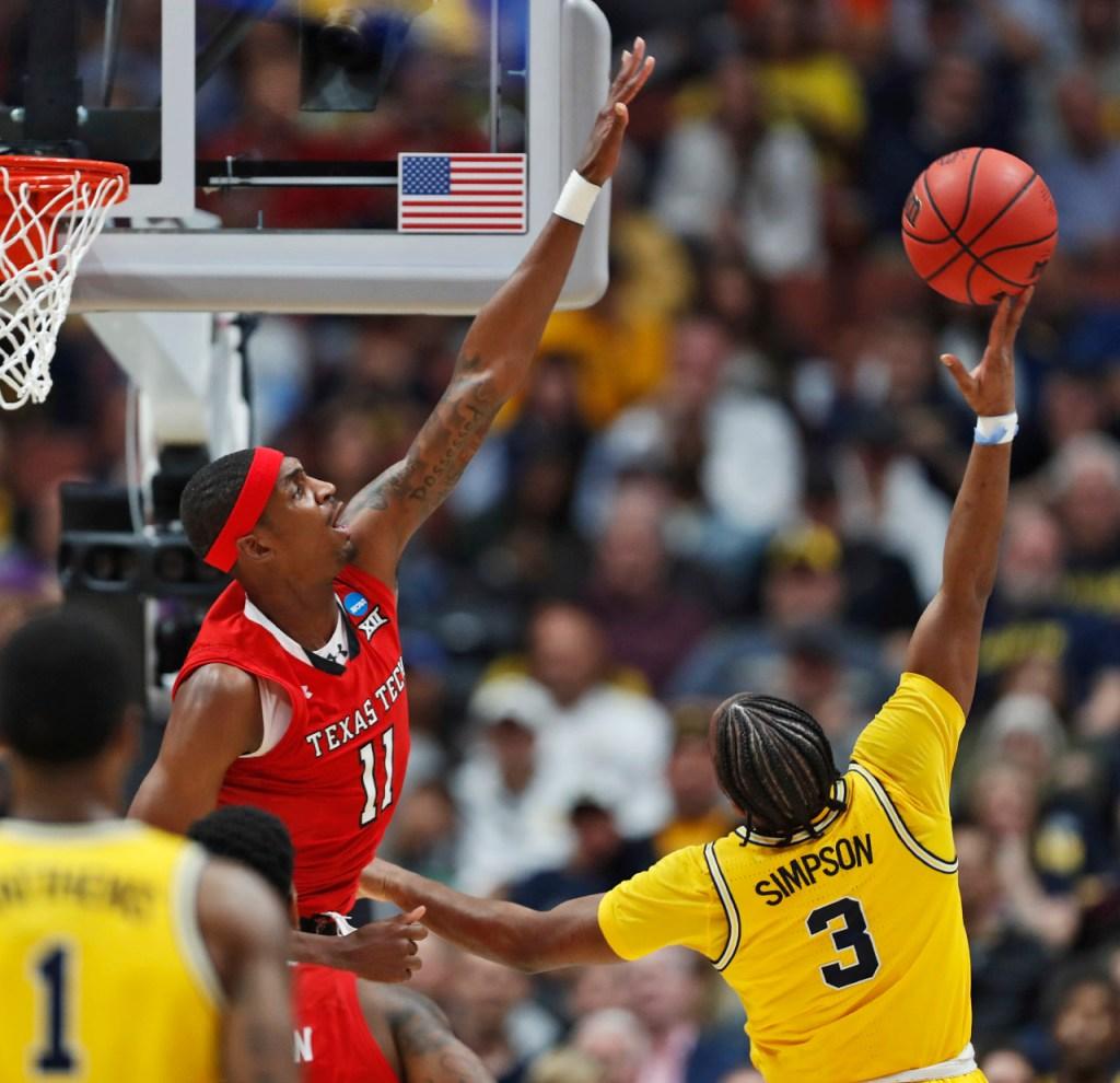 Texas Tech's Tariq Owens (11) blocks a shot by Michigan's Zavier Simpson (3) during the NCAA tournament Sweet 16 game Thursday, March 28, 2019, at Honda Center in Anaheim, Calif. [Brad Tollefson/A-J Media]