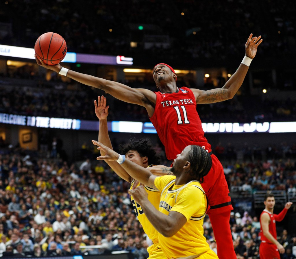 Texas Tech's Tariq Owens (11) rebounds the ball during the NCAA tournament Sweet 16 game against Michigan, Thursday, March 28, 2019, at Honda Center in Anaheim, Calif. [Brad Tollefson/A-J Media]
