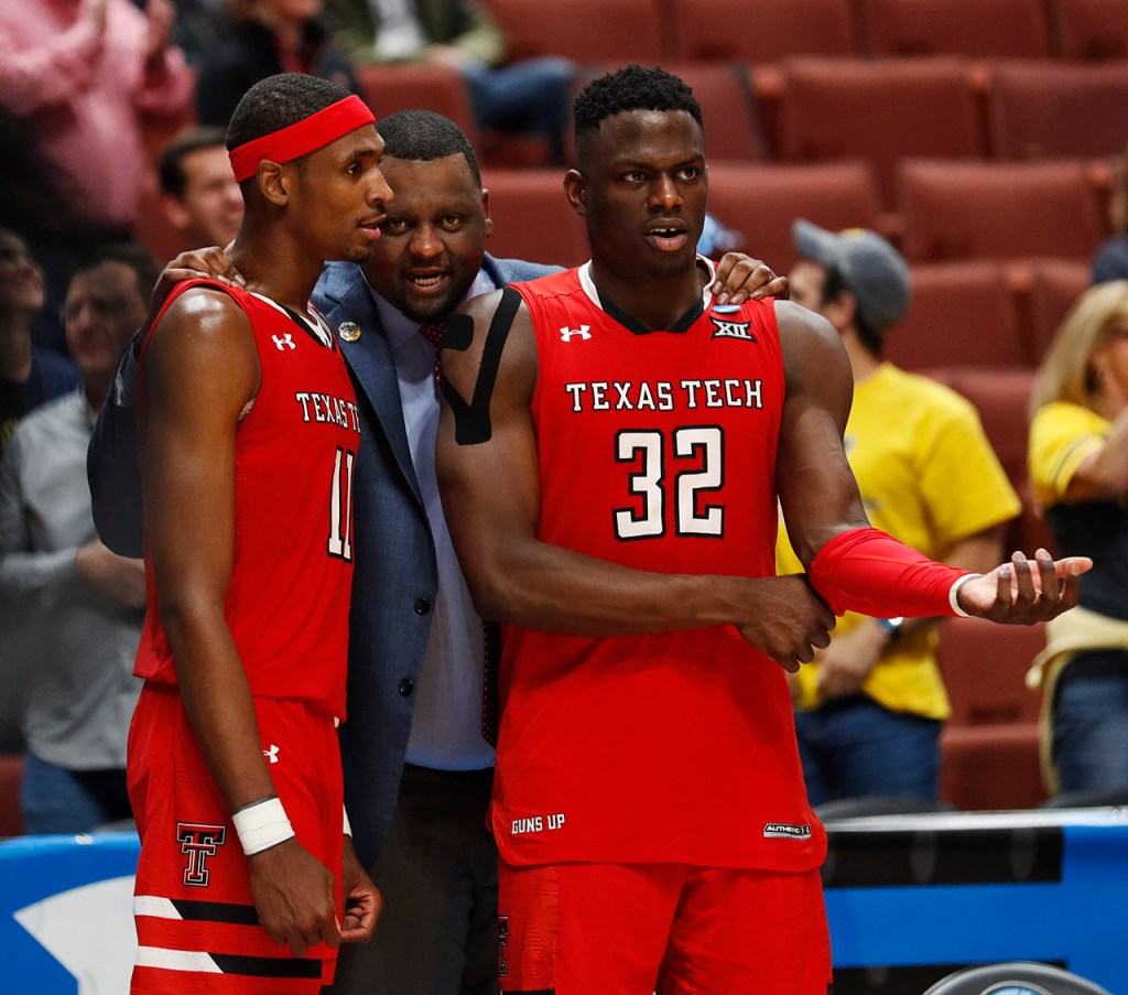 Texas Tech graduate assistant Darryl Dora talks to Tariq Owens (11) and Norense Odiase (32) during the NCAA tournament Sweet 16 game against Michigan Thursday, March 28, 2019, at Honda Center in Anaheim, Calif. [Brad Tollefson/A-J Media]