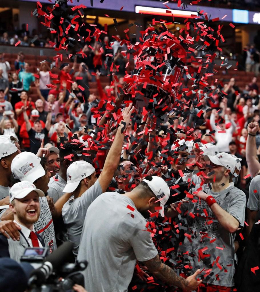 Texas Tech players throw confetti on coach Chris Beard after the NCAA tournament Elite Eight game against Gonzaga, Saturday, March 30, 2019, at Honda Center in Anaheim, Calif. [Brad Tollefson/A-J Media]
