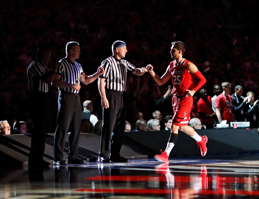 Texas Tech's Davide Moretti (25) fist bumps the referees before the men's basketball national championship against Virginia, Monday, April 8, 2019, at U.S. Bank Stadium in Minneapolis, Minn. [Brad Tollefson/A-J Media]