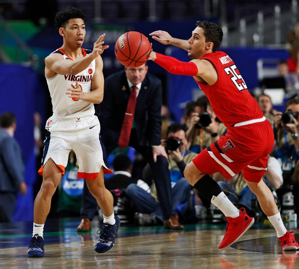 Texas Tech's Davide Moretti (25) deflects a pass by Virginia's Kihei Clark (0) during the men's basketball national championship game against Virginia, Monday, April 8, 2019, at U.S. Bank Stadium in Minneapolis, Minn. [Brad Tollefson/A-J Media]