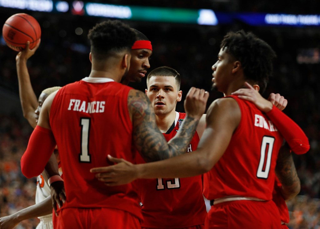 Texas Tech players huddle together during the men's basketball national championship game against Virginia, Monday, April 8, 2019, at U.S. Bank Stadium in Minneapolis, Minn. [Brad Tollefson/A-J Media]