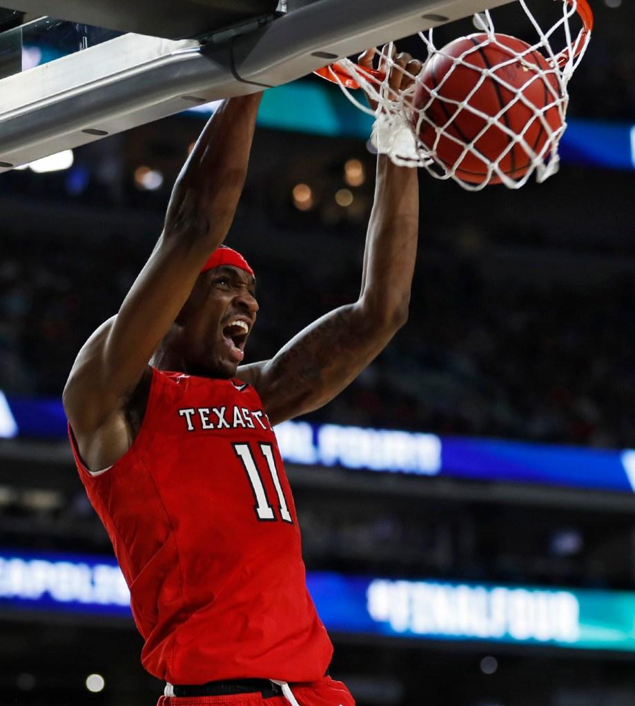 Texas Tech's Tariq Owens (11) dunks the ball during the men's basketball national championship game against Virginia, Monday, April 8, 2019, at U.S. Bank Stadium in Minneapolis, Minn. [Brad Tollefson/A-J Media]