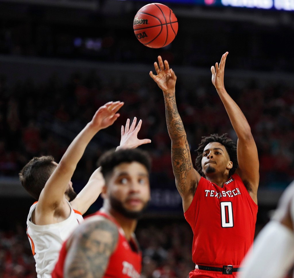 Texas Tech's Kyler Edwards (0) shoots the ball during the men's basketball national championship against Virginia, Monday, April 8, 2019, at U.S. Bank Stadium in Minneapolis, Minn. [Brad Tollefson/A-J Media]