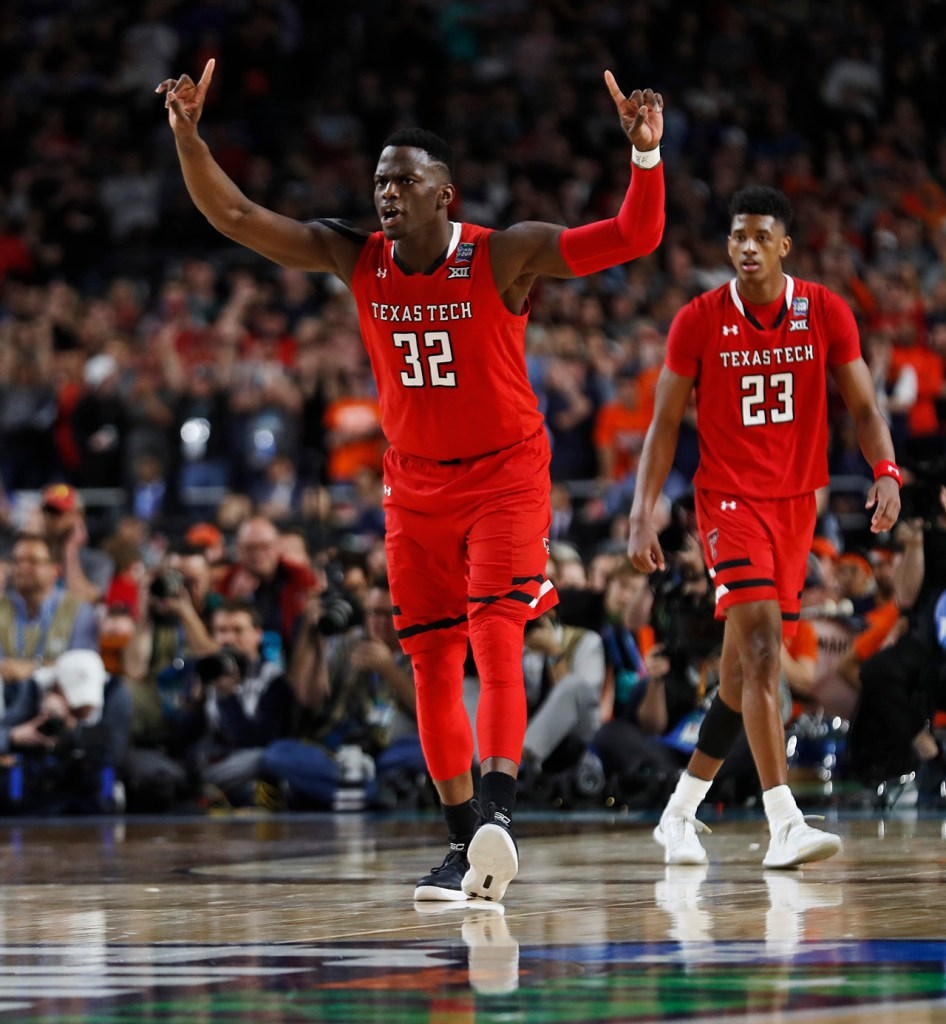Texas Tech's Norense Odiase (32) reacts after scoring a free throw during the men's basketball national championship against Virginia, Monday, April 8, 2019, at U.S. Bank Stadium in Minneapolis, Minn. [Brad Tollefson/A-J Media]