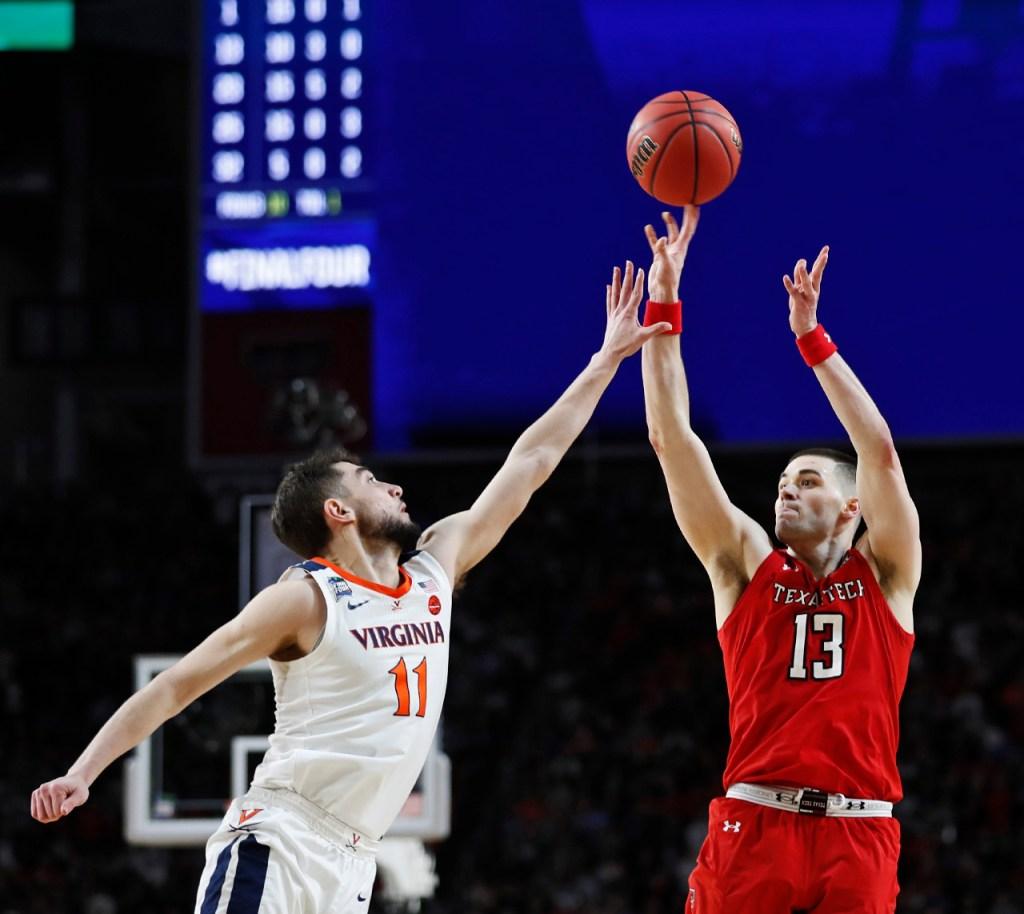 Texas Tech's Matt Mooney (13) shoots the ball over Virginia's Ty Jerome (11) during the men's basketball national championship against Virginia, Monday, April 8, 2019, at U.S. Bank Stadium in Minneapolis, Minn. [Brad Tollefson/A-J Media]