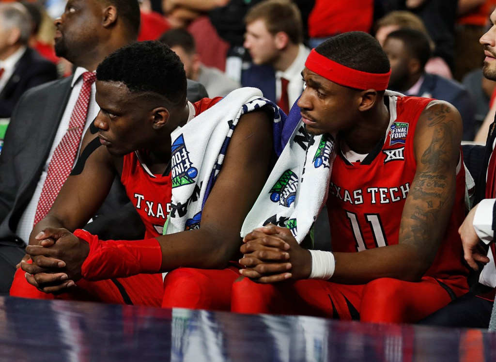 Texas Tech's Norense Odiase (32) and Tariq Owens (11) sit on the bench during the men's basketball national championship game against Virginia, Monday, April 8, 2019, at U.S. Bank Stadium in Minneapolis, Minn. [Brad Tollefson/A-J Media]