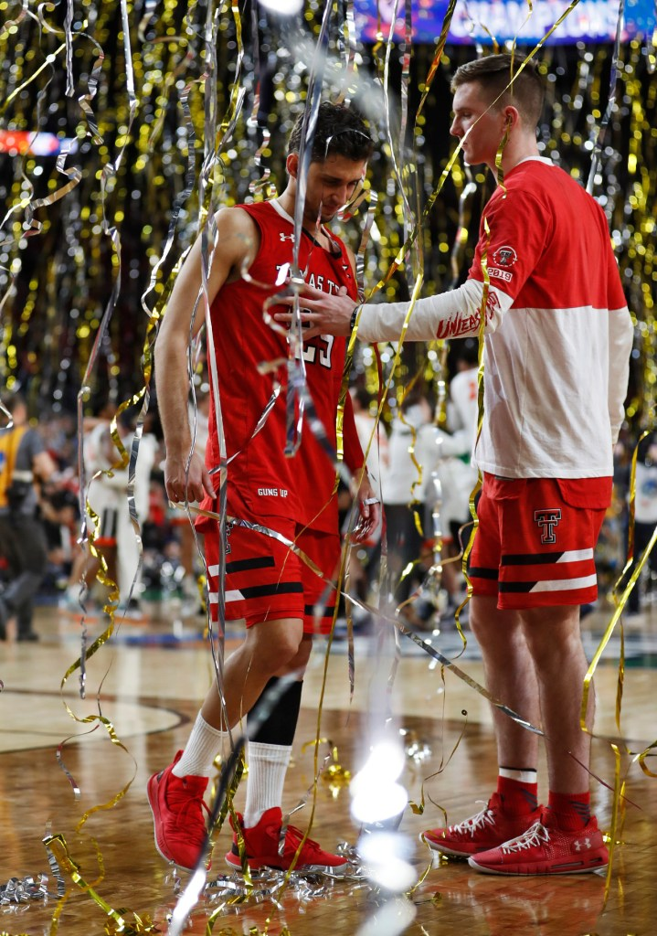 Texas Tech's Parker Hicks (20) holds Texas Tech's Davide Moretti (25) after the men's basketball national championship game against Virginia, Monday, April 8, 2019, at U.S. Bank Stadium in Minneapolis, Minn. [Brad Tollefson/A-J Media]