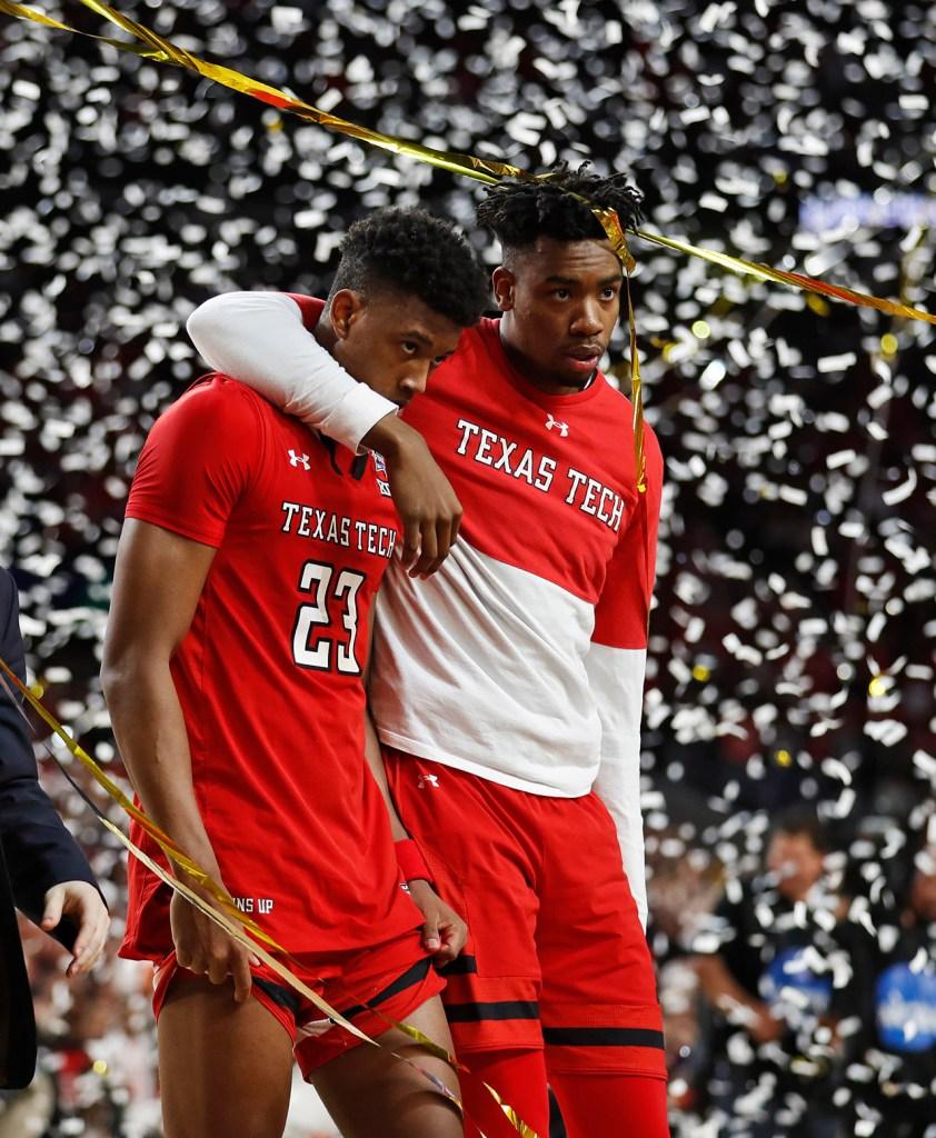 Texas Tech's Malik Ondigo (10) holds Texas Tech's Jarrett Culver (23) after the men's basketball national championship game against Virginia, Monday, April 8, 2019, at U.S. Bank Stadium in Minneapolis, Minn. [Brad Tollefson/A-J Media]