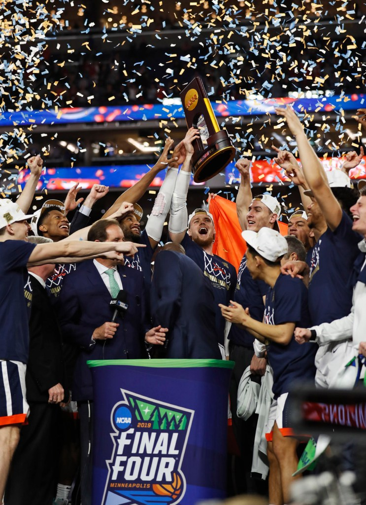 Virginia players celebrate with the trophy after the men's basketball national championship against Virginia, Monday, April 8, 2019, at U.S. Bank Stadium in Minneapolis, Minn. [Brad Tollefson/A-J Media]