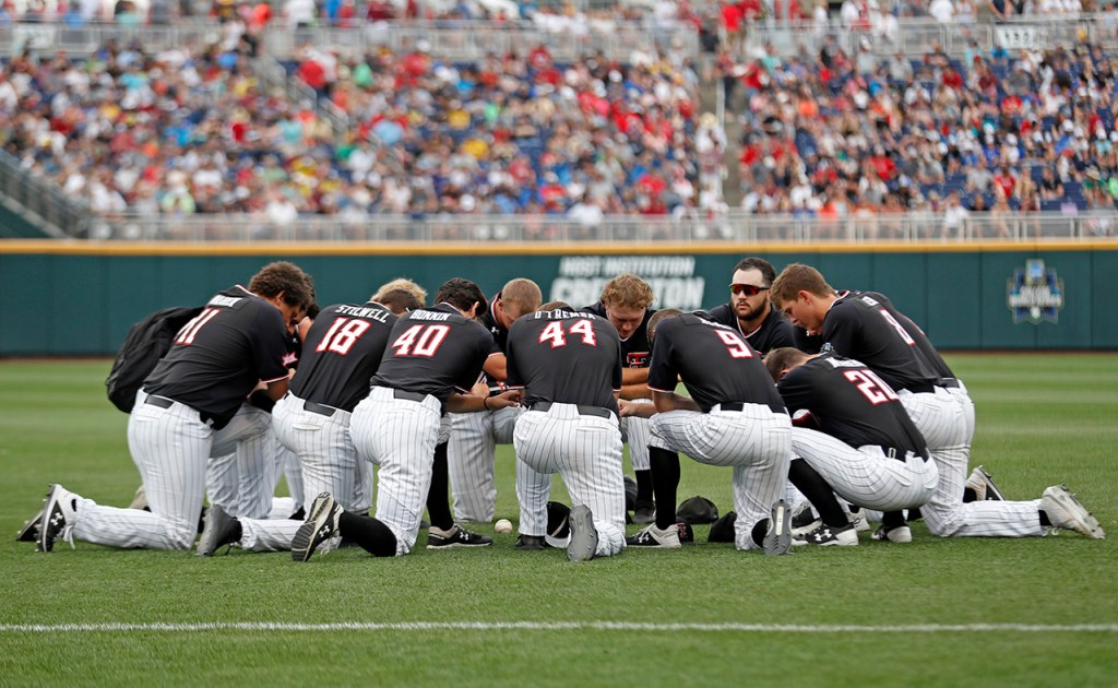Texas Tech players huddle together before the College World Series game against Michigan, Saturday, June 15, 2019, at TD Ameritrade Park in Omaha, Neb. [Brad Tollefson/A-J Media]