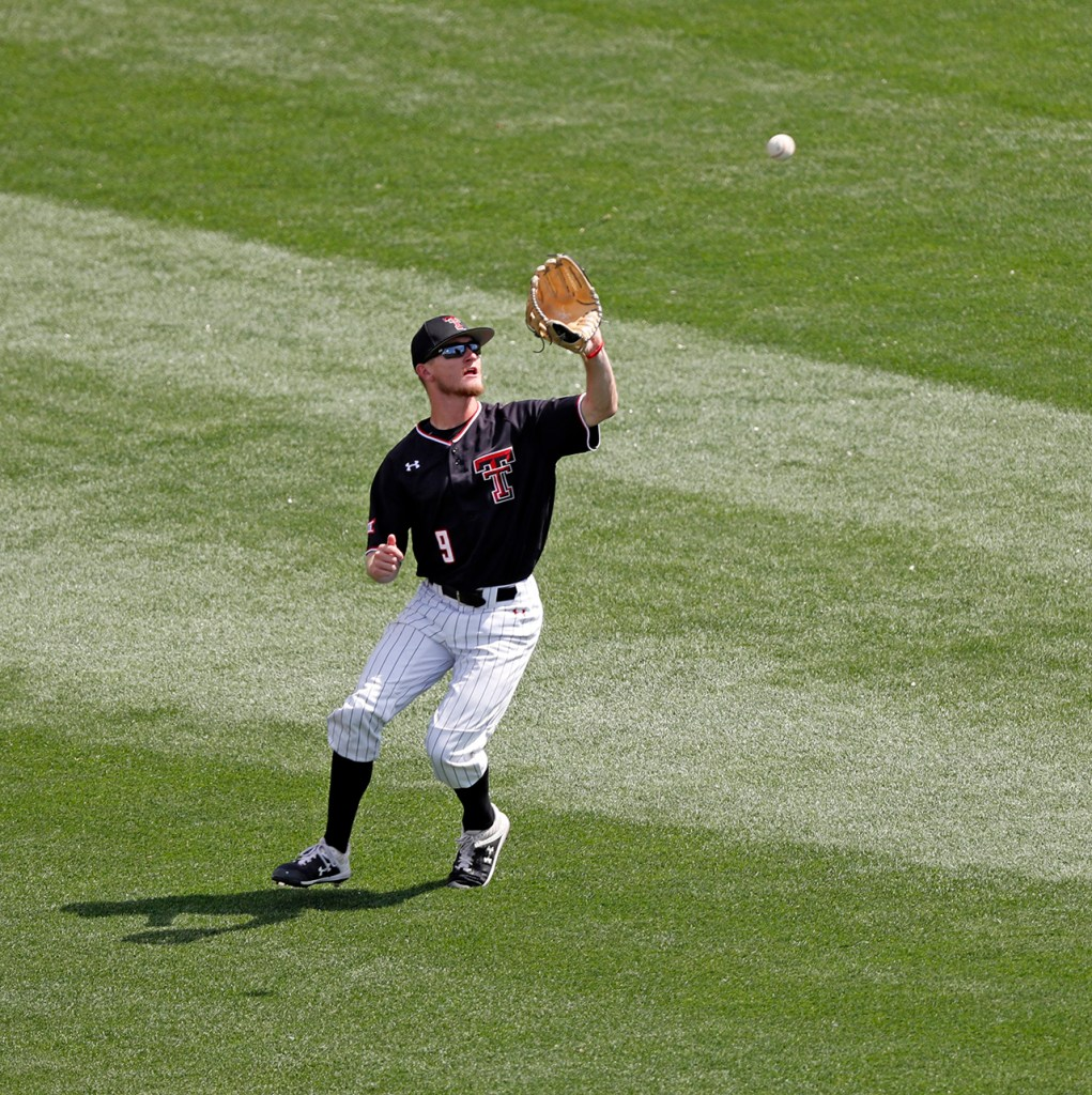 Texas Tech's Dylan Neuse (9) catches a fly ball during the College World Series game against Michigan, Saturday, June 15, 2019, at TD Ameritrade Park in Omaha, Neb. [Brad Tollefson/A-J Media]
