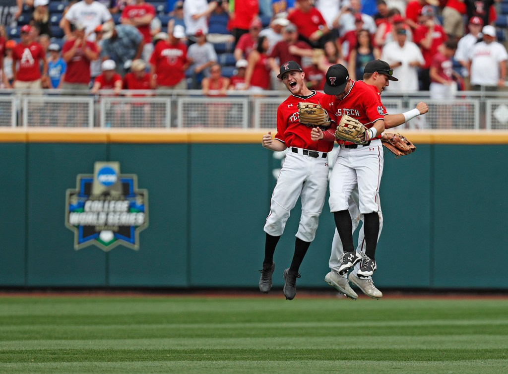 Texas Tech's Kurt Wilson (8), Dylan Neuse (9) and Max Marusak (20) celebrate in the outfield during the College World Series game against Arkansas, Monday, June 17, 2019, at TD Ameritrade Park in Omaha, Neb. [Brad Tollefson/A-J Media]
