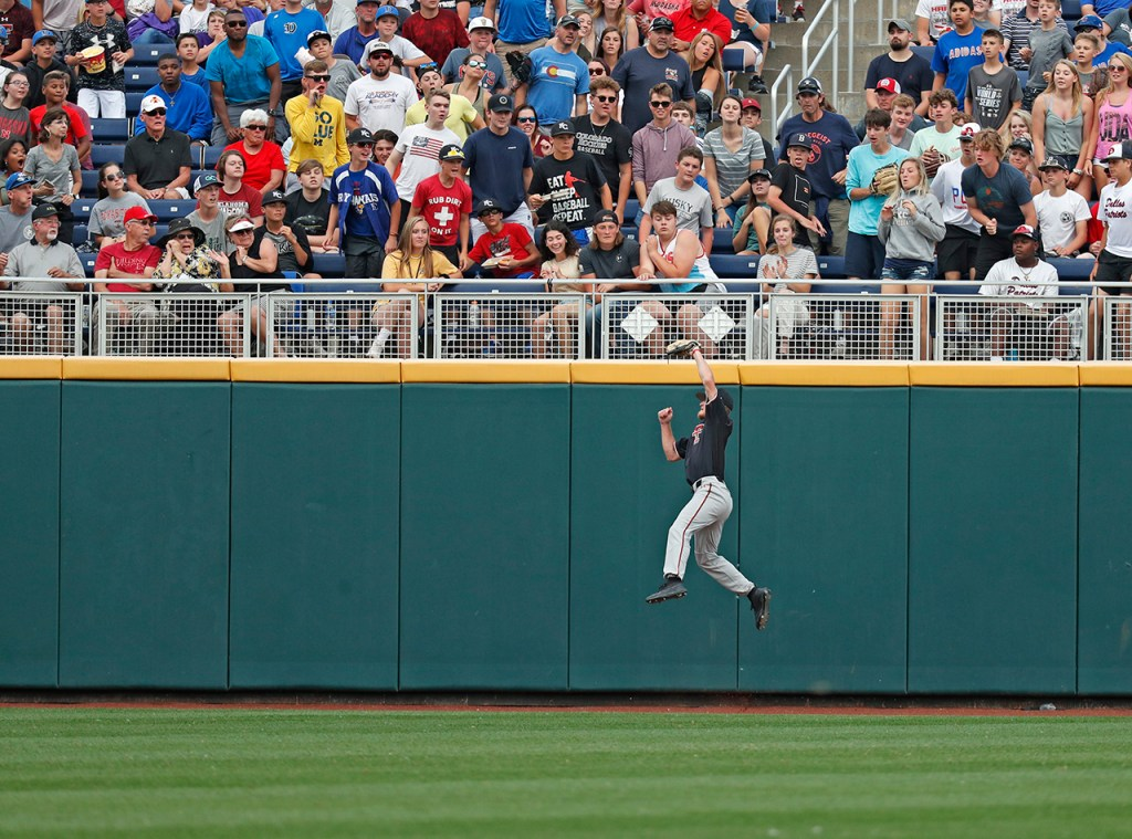 Texas Tech's Dylan Neuse (9) catches a fly ball during the College World Series game against Florida State, Wednesday, June 19, 2019, at TD Ameritrade Park in Omaha, Neb. [Brad Tollefson/A-J Media]