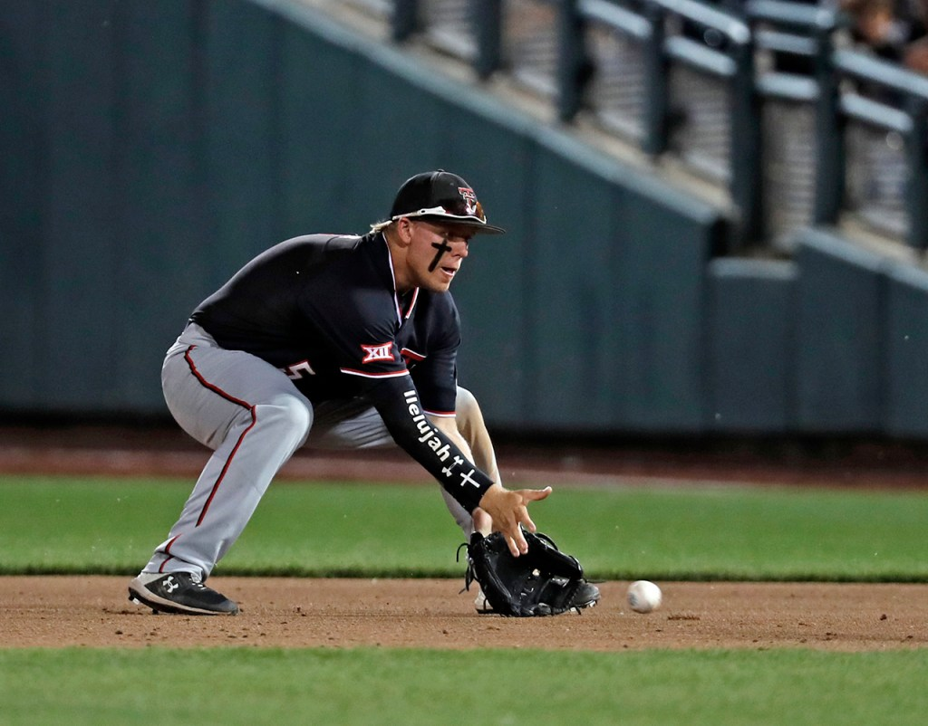 Texas Tech's Brian Klein (5) fields a ground ball during the College World Series game against Florida State, Wednesday, June 19, 2019, at TD Ameritrade Park in Omaha, Neb. [Brad Tollefson/A-J Media]