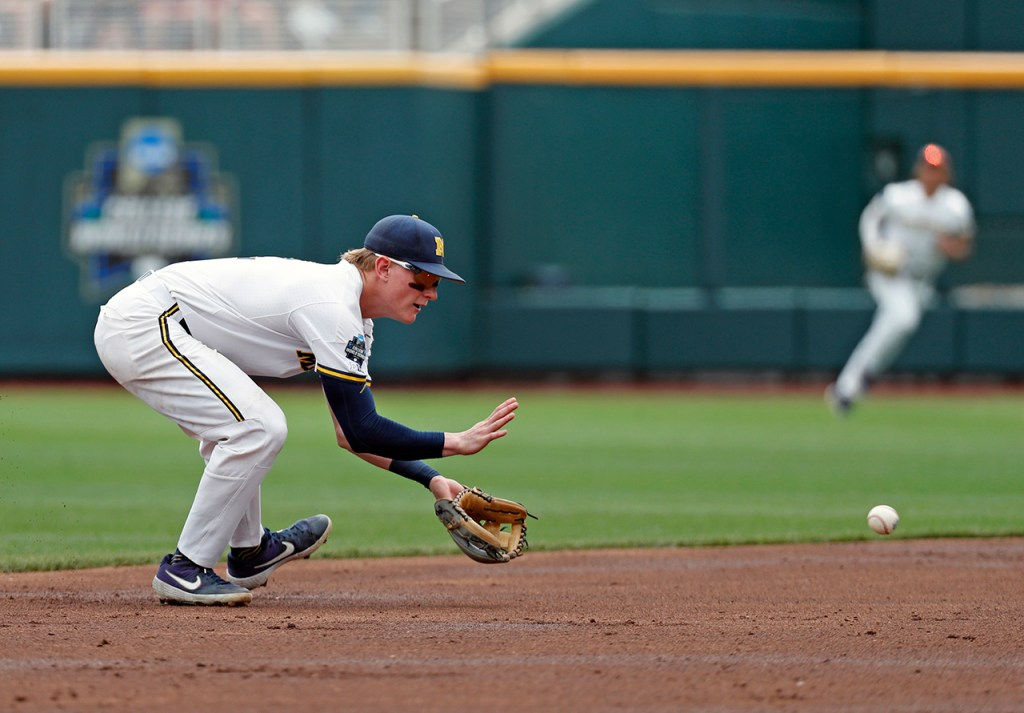 Michigan's Jack Blomgren (2) fields a ground ball during the College World Series game against Texas Tech, Friday, June 21, 2019, at TD Ameritrade Park in Omaha, Neb. [Brad Tollefson/A-J Media]