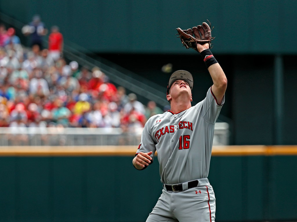 Texas Tech's Josh Jung (16) catches a fly ball during the College World Series game against Michigan, Friday, June 21, 2019, at TD Ameritrade Park in Omaha, Neb. [Brad Tollefson/A-J Media]