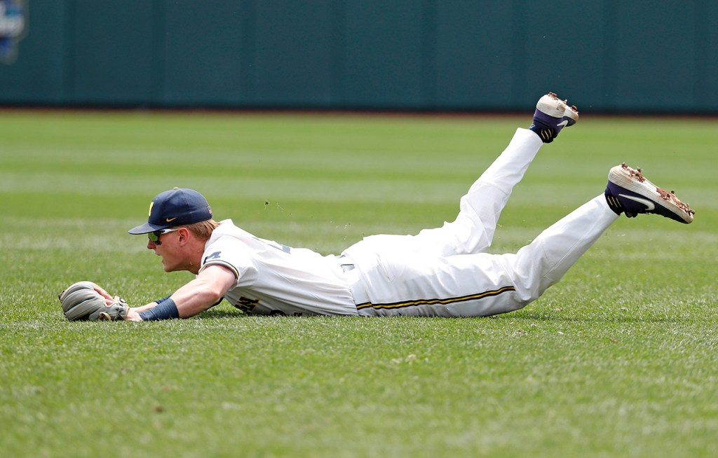 Michigan's Jack Blomgren (2) misses a ground ball during the College World Series game against Texas Tech, Friday, June 21, 2019, at TD Ameritrade Park in Omaha, Neb. [Brad Tollefson/A-J Media]