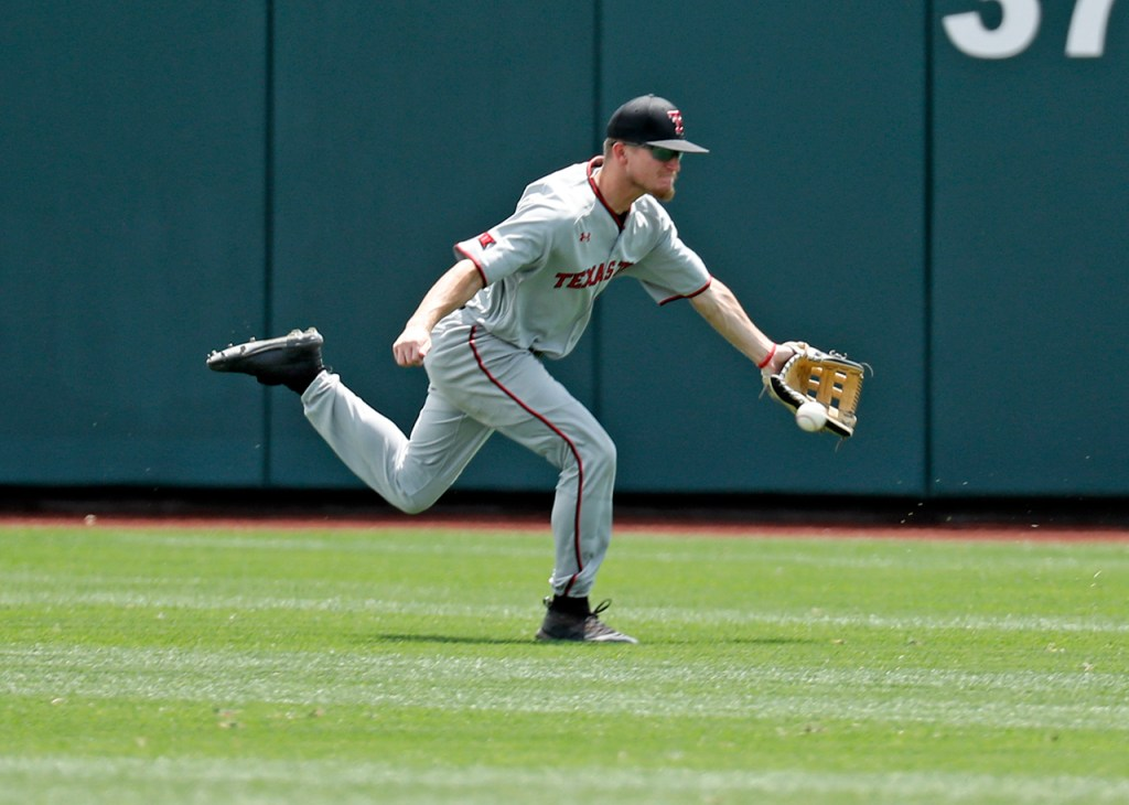 Texas Tech's Dylan Neuse (9) misses a ground ball during the College World Series game against Michigan, Friday, June 21, 2019, at TD Ameritrade Park in Omaha, Neb. [Brad Tollefson/A-J Media]