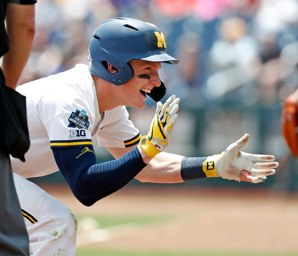 Michigan's Jack Blomgren (2) celebrates after hitting a triple during the College World Series game against Texas Tech, Friday, June 21, 2019, at TD Ameritrade Park in Omaha, Neb. [Brad Tollefson/A-J Media]