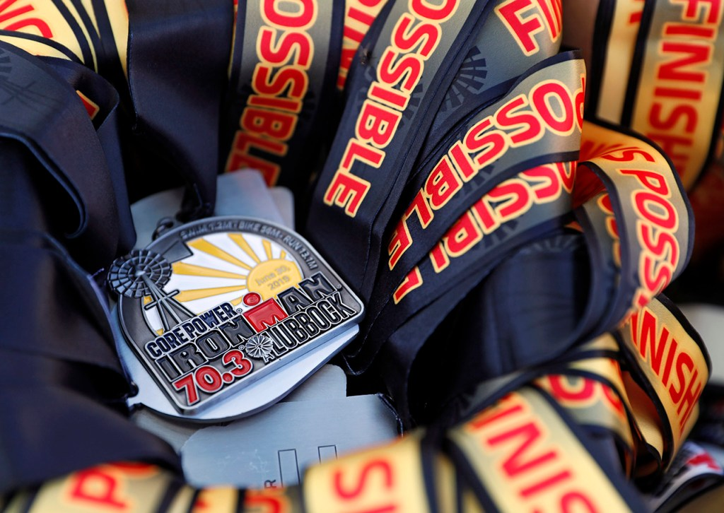 Finisher medals during the Ironman 70.3 Lubbock, Sunday, June 30, 2019, at Texas Tech in Lubbock, Texas. [Brad Tollefson/A-J Media]