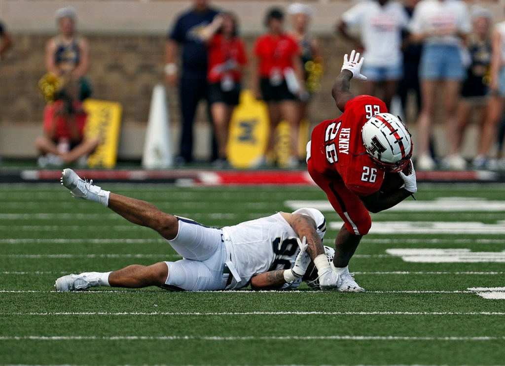 Texas Tech's Ta'Zhawn Henry (26) is tackled by Montana State's Amandre Williams (96) during the first half of the NCAA college football game Saturday, Aug. 31, 2019, in Lubbock, Texas. [Brad Tollefson/A-J Media]