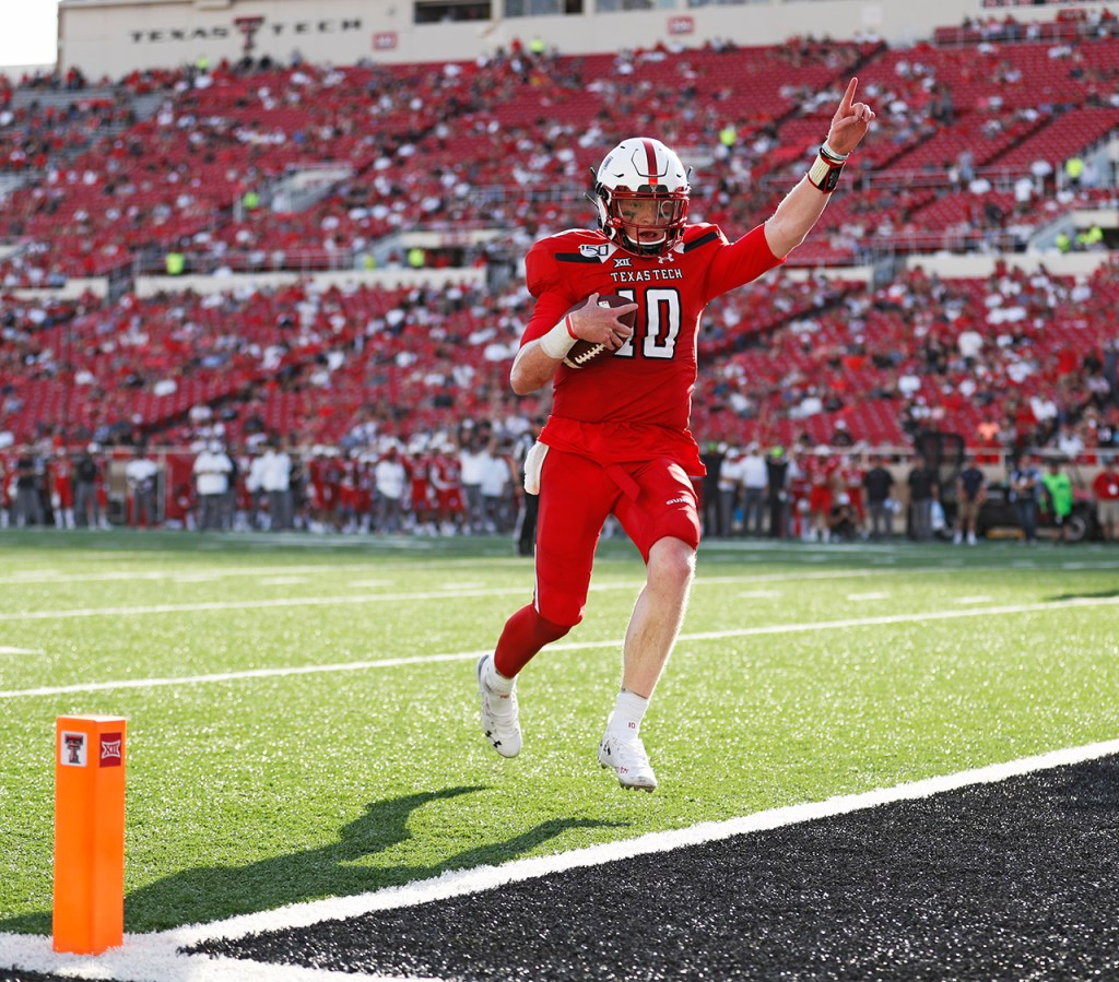 Texas Tech's Alan Bowman (10) scores a touchdown during the second half of the NCAA college football game against Montana State, Saturday, Aug. 31, 2019, in Lubbock, Texas. [Brad Tollefson/A-J Media]
