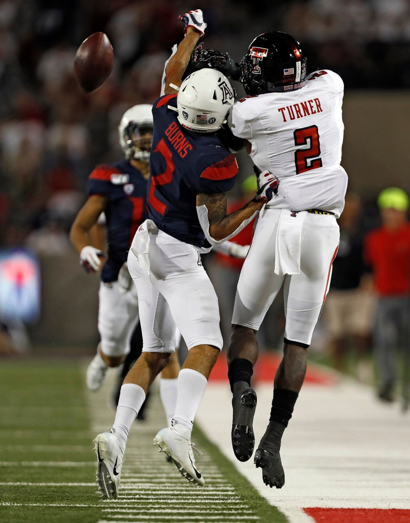 Arizona's Lorenzo Burns (2) breaks up a pass intended for Texas Tech's RJ Turner (2) during the game Saturday, Sept. 14, 2019, at Arizona Stadium in Tucson, Ariz. [Brad Tollefson/A-J Media]
