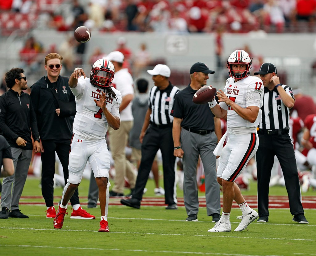 Texas Tech's Jett Duffey (7) and Jackson Tyner (17) throw passes while warming up before the game against Oklahoma, Saturday, Sept. 28, 2019, at Gaylord Memorial Stadium in Norman, Okla. [Brad Tollefson/A-J Media]