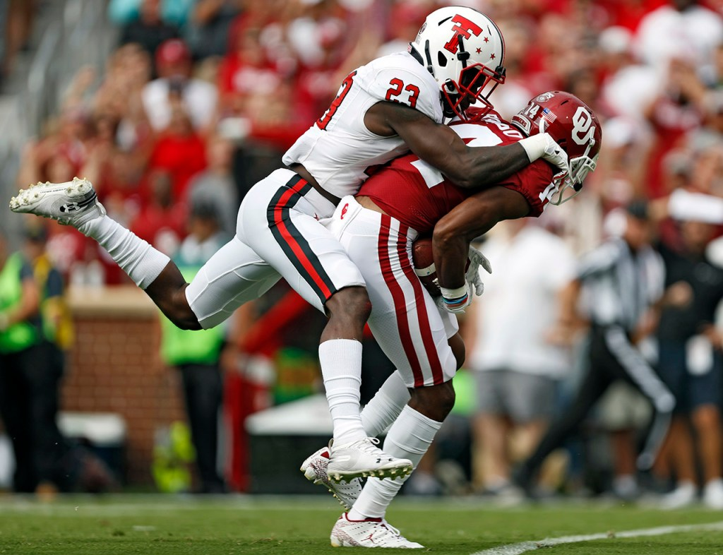 Texas Tech's Damarcus Fields (23) tackles Oklahoma's Charleston Rambo (14) during the game Saturday, Sept. 28, 2019, at Gaylord Memorial Stadium in Norman, Okla. [Brad Tollefson/A-J Media]
