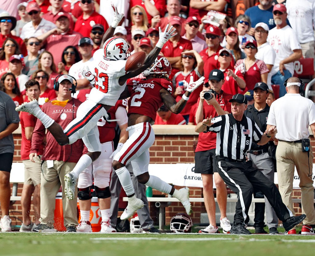 Oklahoma's CeeDee Lamb (2) receives an offensive pass interference call while trying to catch the pass around Texas Tech's Damarcus Fields (23) during the game Saturday, Sept. 28, 2019, at Gaylord Memorial Stadium in Norman, Okla. [Brad Tollefson/A-J Media]