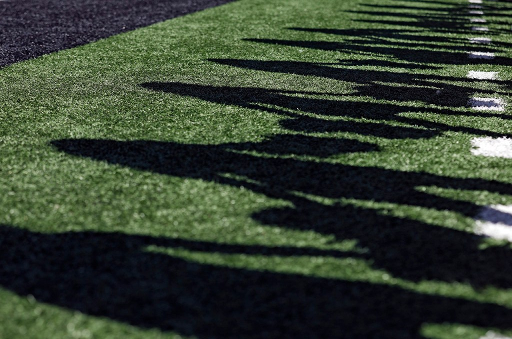 Shadows of Texas Tech pom squad members as they perform during the game against Oklahoma State, Saturday, Oct. 5, 2019, in Lubbock, Texas. (AP Photo/Brad Tollefson)