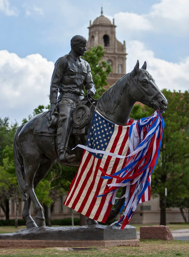 American flags and crepe paper hang from the statue of Will Rogers and Soapsuds following the news that Osama bin Laden was killed Monday, May 2, 2011, in Lubbock, Texas. (Brad Tollefson/The Daily Toreador)