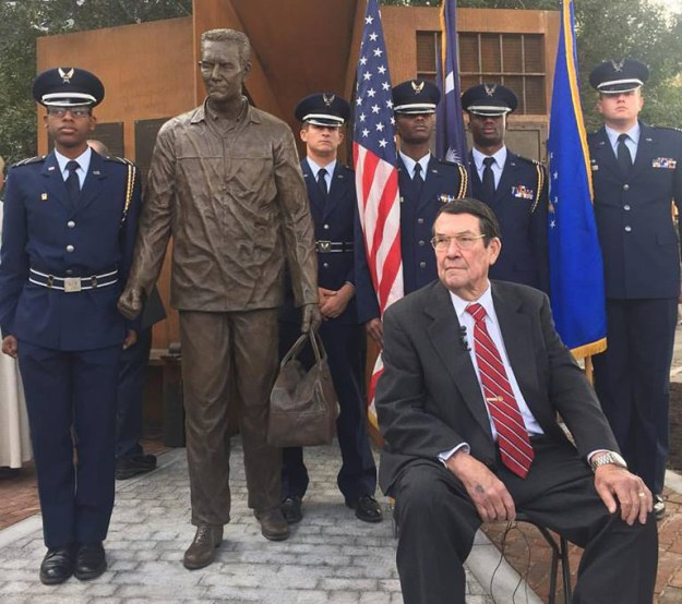 Jack Van Loan, seated, at the dedication of his statue in Five Points in 2016.